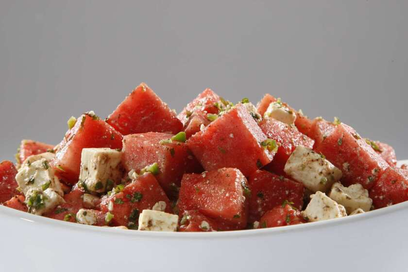 Watermelon salad with feta, mint and cumin-lime dressing.