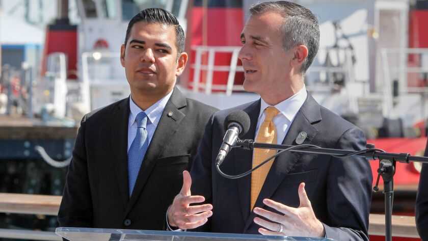 Los Angeles Mayor Eric Garcetti, right, and Long Beach Mayor Robert Garcia announce the signing of a joint declaration for clean air goals in the ports of Los Angeles and Long Beach.