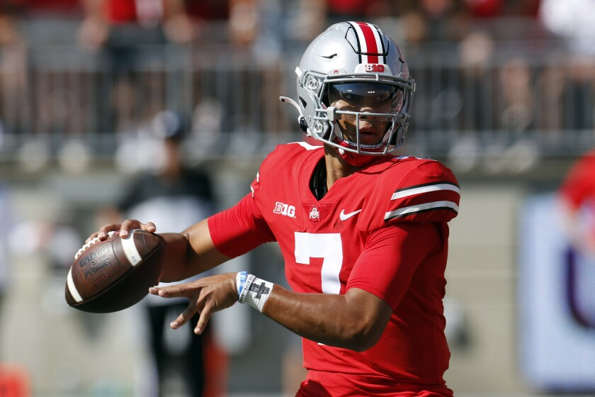 Ohio State quarterback C.J. Stroud drops back to pass against Maryland during the first half of an NCAA college football game Saturday, Oct. 9, 2021, in Columbus, Ohio. (AP Photo/Jay LaPrete)