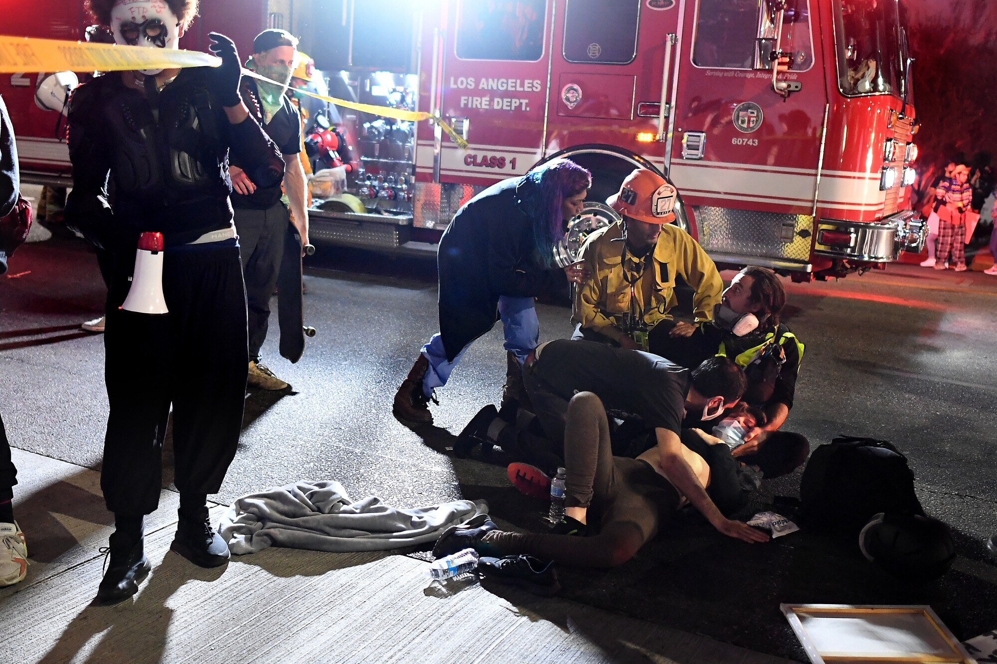 Paramedics arrive after a protester was hit by a truck in Hollywood