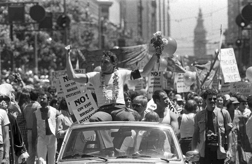 Harvey Milk rides in a gay pride parade in San Francisco in 1978. He was fatally shot later that year.