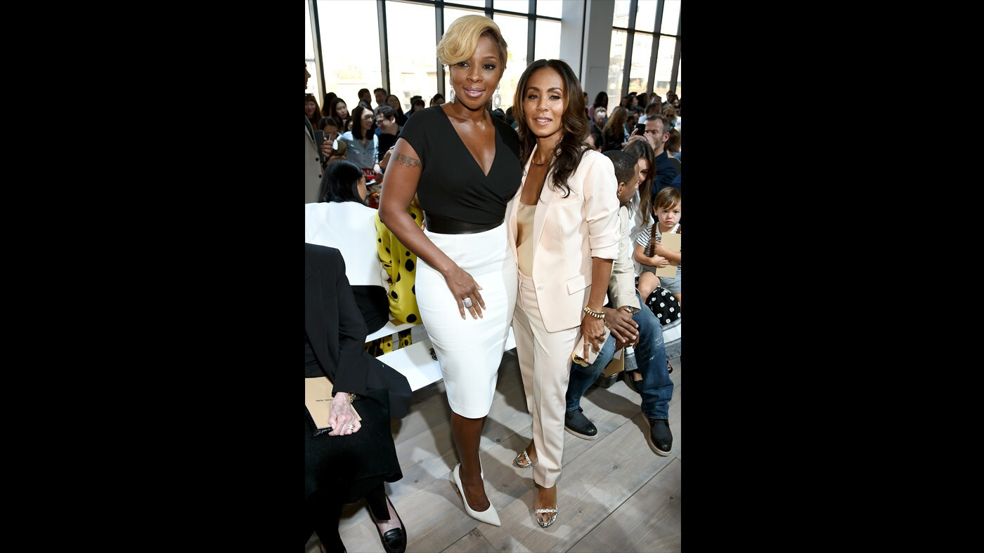 Mary J. Blige, left, and Jada Pinkett Smith attend the Michael Kors show on Sept. 10.