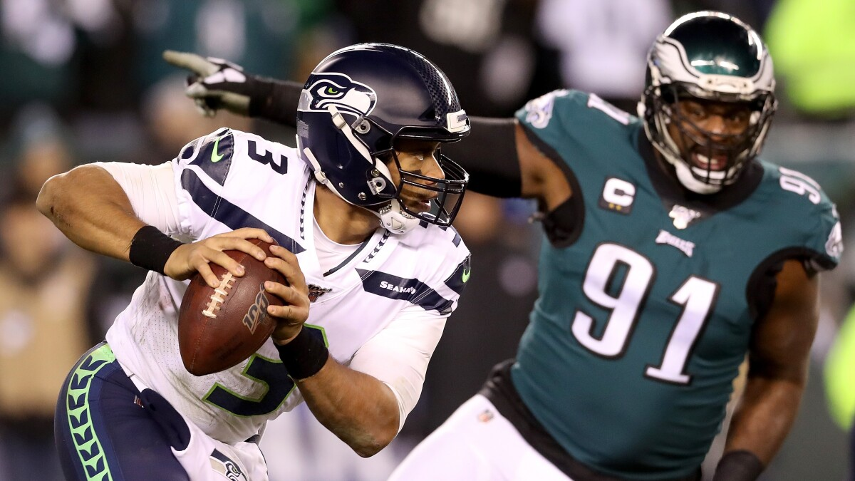 Nfl Playoffs Seahawks Defeat Eagles After Carson Wentz Injury Los Angeles Times