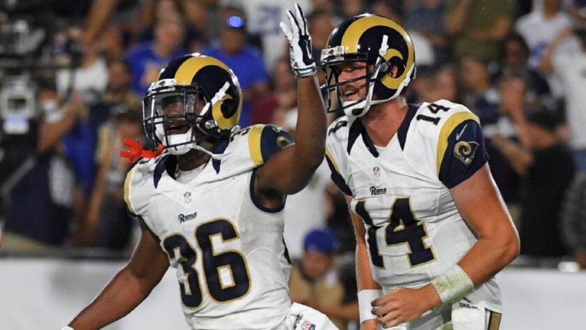 Rams running back Aaron Green (36) celebrates after scoring the go-ahead touchdown on a nine-yard pass from quarterback Sean Mannion (14) on Aug. 13.