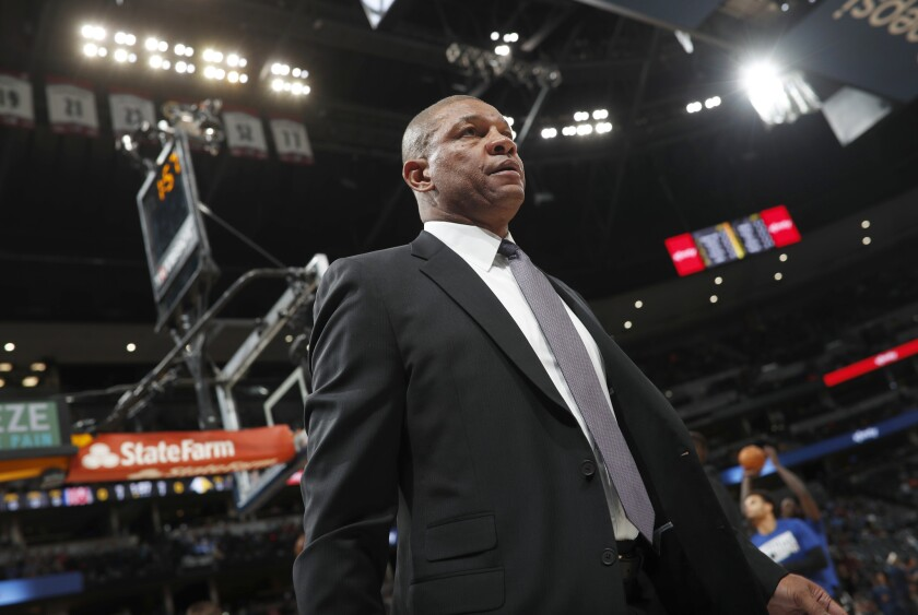 Clippers coach Doc Rivers walks on the court before a game.