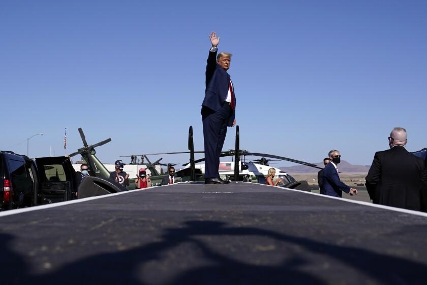 President Trump waves at Prescott Regional Airport in Prescott, Ariz.
