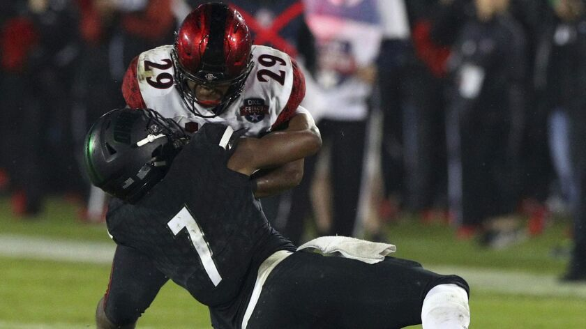 San Diego State running back Juwan Washington (29) gets tackled by Ohio safety Javon Hagan in the second half of the Frisco Bowl on Wednesday. Ohio won 27-0.