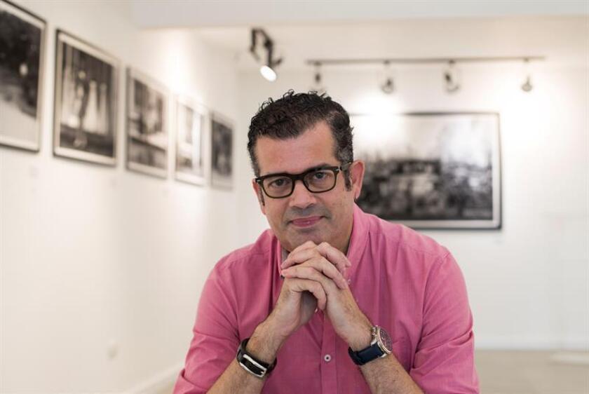 Dominica photographer and musician Roger Zayas, band member of 440 lead by Juan Luis Guerra,at his art exhibit 'Travesías',Nov 15, 2018, in Santo Domingo (Dominican Republic). EPA-EFE/Orlando Barría