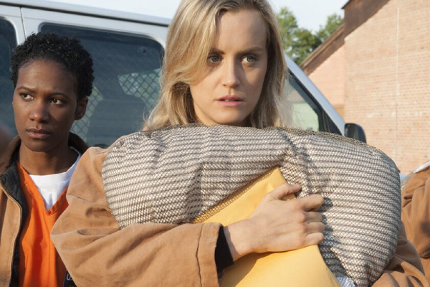"""A new study from Nielsen found users of online video services Netflix, Hulu and Amazon Prime Instant Video love to binge on TV shows. Netflix subscribers say they also are attracted to original content, such as the acclaimed new prison comedy """"Orange is the New Black,"""" starring Taylor Schilling, center, and Vicky Jeudy."""