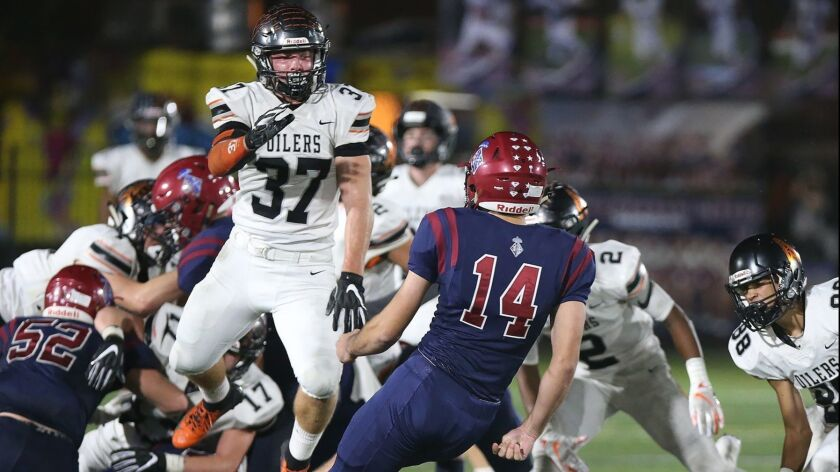 Huntington Beach linebacker John Gosney (37) blocks a field goal in the first round of the CIF South