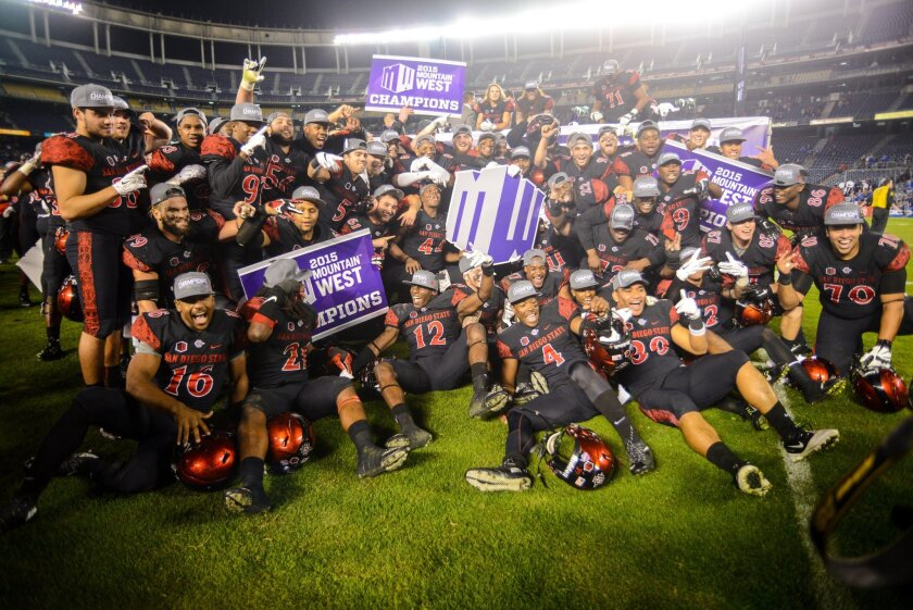 The San Diego State football program, here celebrating last season's Mountain West Conference championship victory over Air Force at Qualcomm Stadium, could do so much better in a better stadium.