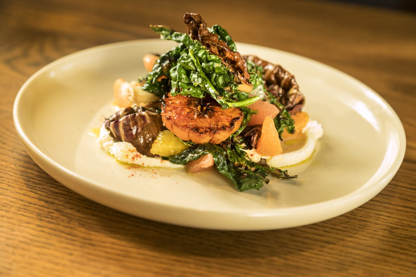 Charred chicories with citrus, pistachios and forage blanc. In addition to a lively bar, the Hearth & Hound offers a wine list pulled together by Beastie Boy Mike D.