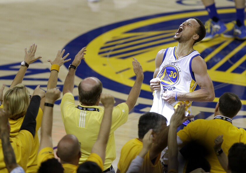 FILE - In this May 30, 2016, file photo, fans cheer as Golden State Warriors guard Stephen Curry yells after the Warriors beat the Oklahoma City Thunder in Game 7 of the NBA basketball Western Conference finals in Oakland, Calif. The roar of the crowd has been a staple of major sports and an advantage for the home team. Playing in empty buildings would require a significant recalibration. (AP Photo/Ben Margot, File)
