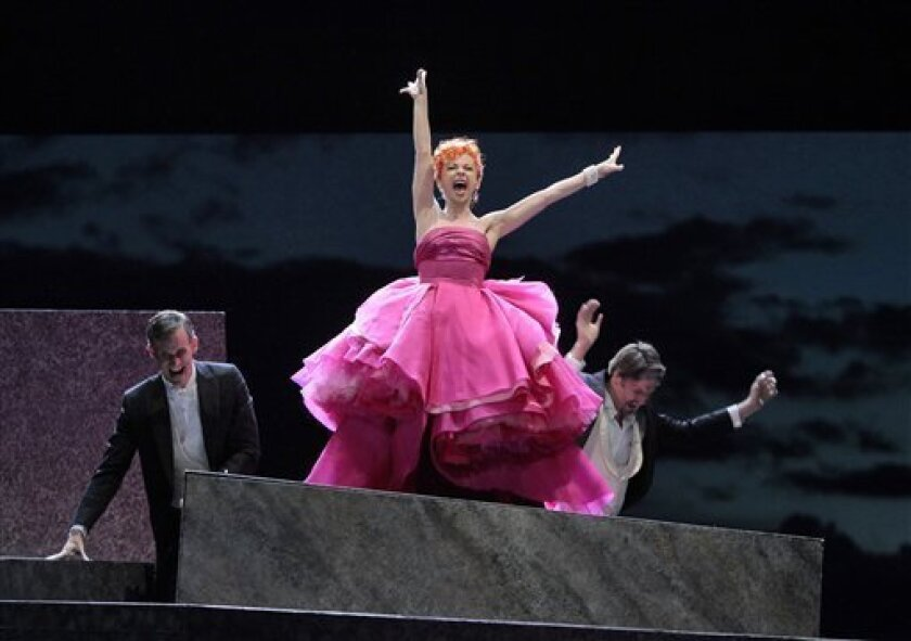 """In this image released by the Santa Fe Opera, French soprano Natalie Dessay, center, is shown during a performance of Verdi's """"La Traviata,"""" at the Santa Fe Opera in Santa Fe, N.M. (AP Photo/Sata Fe Opera, Ken Howard)"""