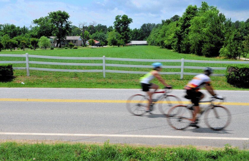 Cyclists participate in the Bike Virginia tour. The route, here in Pocahontas State Park in Chesterfield County, is roughly from Richmond to Williamsburg.