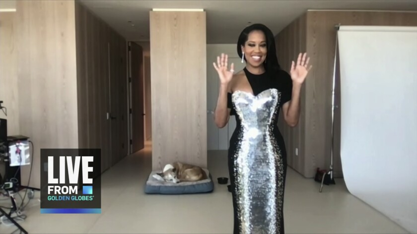 Regina King shows off her gown during the 78th Golden Globes telecast.
