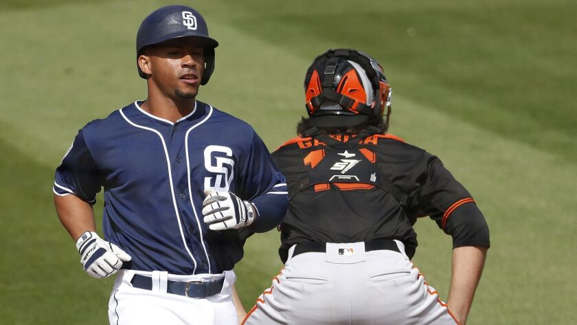 San Francisco Giants catcher Aramis Garcia waits for the throw as San Diego Padres' Francisco Mejia