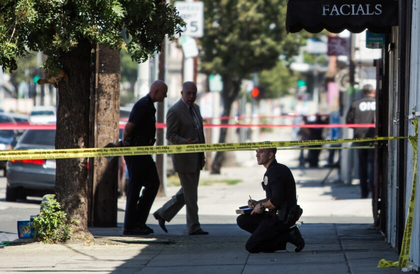 Los Angeles police investigate after officers fatally shot a woman near East 22nd and San Pedro streets near downtown L.A. in September 2015.