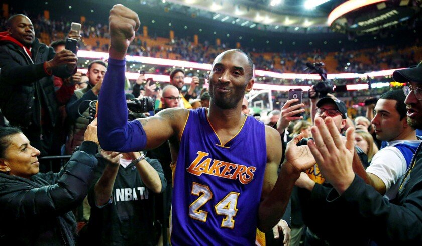 The Lakers' Kobe Bryant acknowledges the fans as he walks off the court in Boston after the Lakers' 112-104 win over the Celtics on Wednesday.