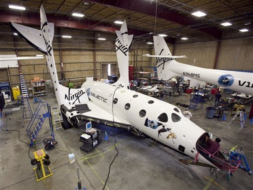 This image provided by Mark Greenberg/Virgin Galactic shows SpaceShip2 preparations for the test flight in Mojave, Calif. Virgin Galactic's space tourism rocket SpaceShipTwo may fly free in its first glide test later this year, a company official said Friday July 23, 2010. The six-passenger spacesh