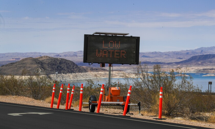 """A sign at Lake Mead says """"low water"""""""