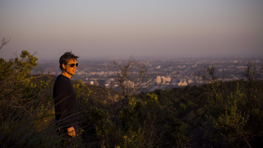 Investor and philanthropist Nicolas Berggruen, 54, looks west at sunset from atop a peak on the 450 acres he purchased in the Sepulveda Pass.