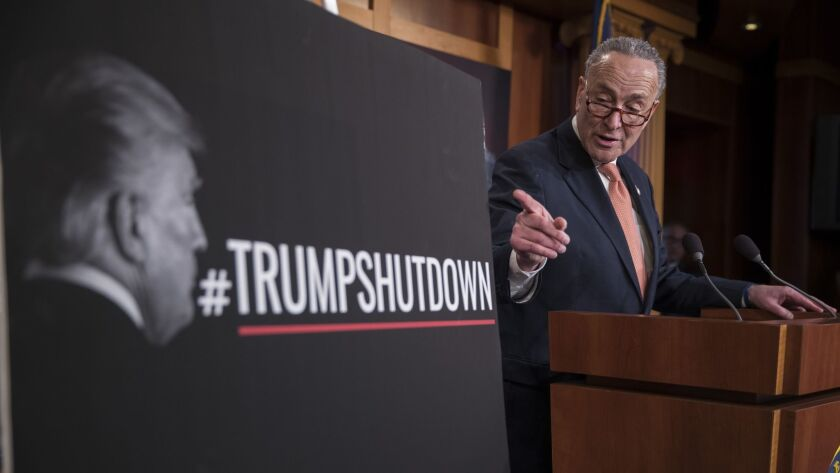 Senate Minority Leader Charles E. Schumer (D-N.Y.) discusses the government shutdown at a news conference hours after it took effect.