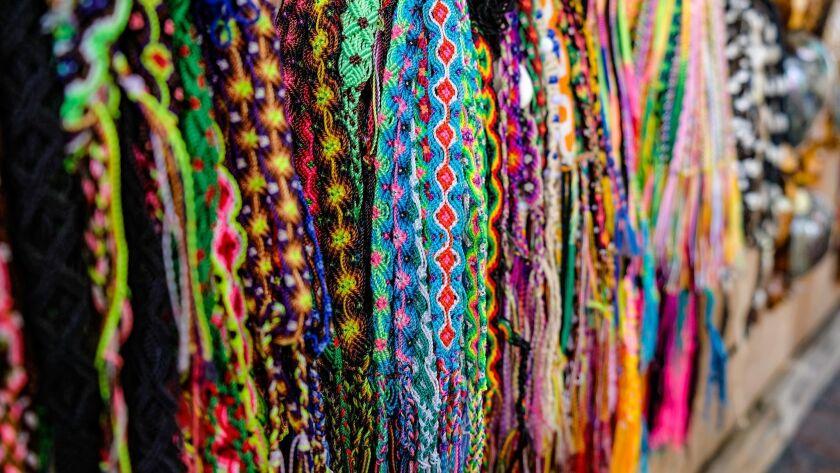 Vendors on Calle 16 de Septiembre sell vanilla, art, jewelry, pottery, and handmade crafts. Benjamin