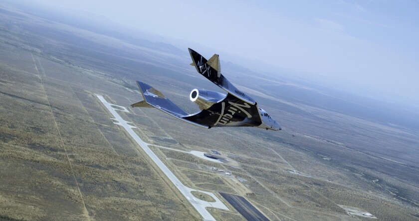 This photo provided by Virgin Galactic shows SpaceShipTwo Unity on it's second successful glide flight over Spaceport America in New Mexico on Thursday, June 25, 2020. Virgin Galactic is celebrating the second successful glide flight of its spaceship over Spaceport America in southern New Mexico. (Virgin Galactic via AP)