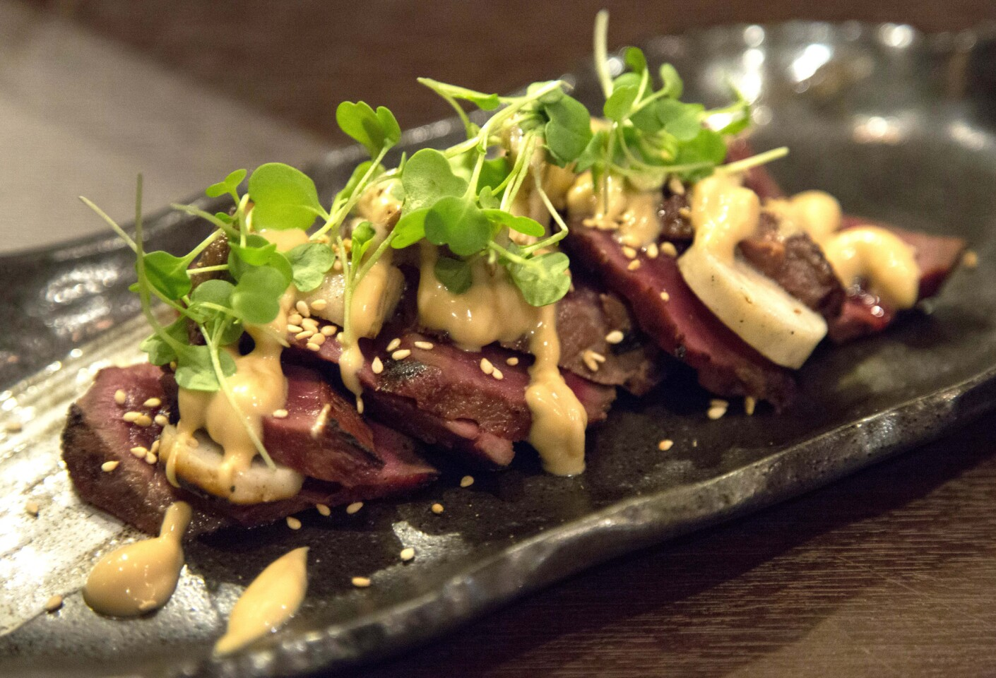 Grilled miso heart served with king oyster mushrooms and yuzi miso vinaigrette.