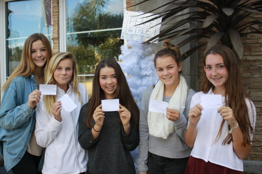 Dana Waldburger, Charli Davey, Caroline Garay, Daisy Hathaway and Sam Osman with their messages for peace in the New Year.