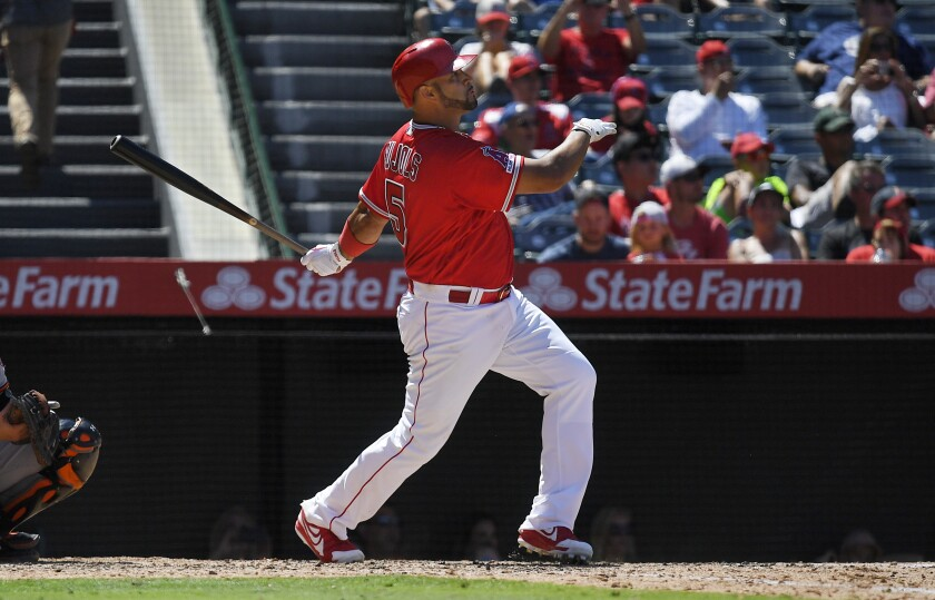 Angels slugger Albert Pujols hits a two-run home run during the sixth inning.