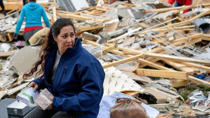 Kim Nicholson sits amid the debris of her home on Feb. 25, 2018, after a storm hit the area around Clarksville, Tenn.