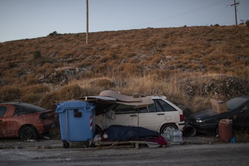 Migrants sleep on the roadside on the island of Lesbos, Greece.