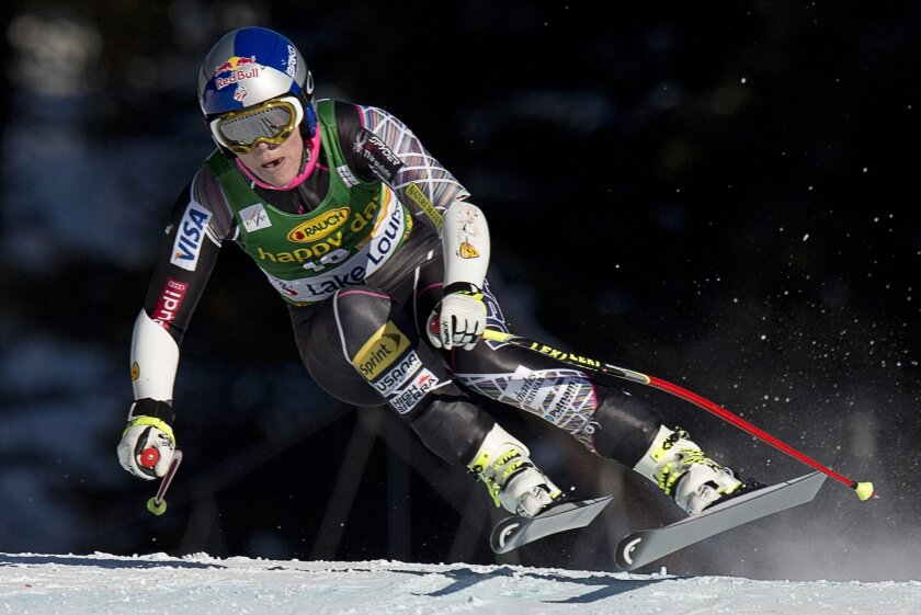 """FILE - In this Dec. 8, 2013 file photo, Lindsey Vonn races during the women's World Cup super-G skiing event at Lake Louise, Alberta, Canada. Vonn is going to skip the Sochi Olympics because of a right knee injury. Her personal publicist, Lewis Kay, says in a statement Tuesday, Jan. 7, 2014, that Vonn """"will have surgery shortly."""" The 29-year-old American won two medals at the 2010 Vancouver Olympics, including a gold in the downhill. She is also a four-time overall World Cup champion and the biggest name in Alpine skiing. (AP Photo/The Canadian Press, Jonathan Hayward)"""