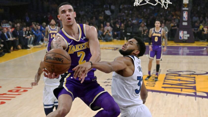 Lakers guard Lonzo Ball tries to score against Minnesota Timberwolves center Karl-Anthony Towns during their game Wednesday.