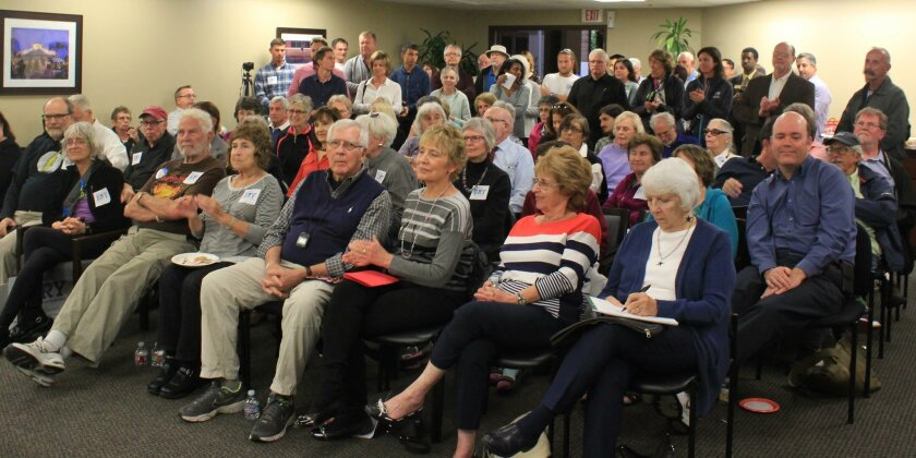 About 80 people packed the community room at La Jolla Village Square to hear the candidates speak.