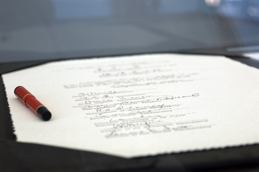 In this Aug. 15, 2020, photo, signed surrender documents from World War II are shown on the USS Missouri Memorial in Pearl Harbor, Hawaii. Some veterans and government officials will gather Wednesday, Sept. 2, 2020, in Hawaii to mark the 75th anniversary of the surrender. (AP Photo/Caleb Jones)