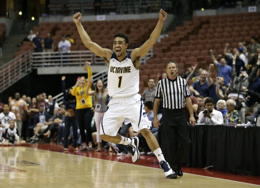 UC Irvine's Alex Young celebrates the team's 67-58 win against Hawaii in an NCAA college basketball game for the Big West Conference tournament championship, Saturday, March 14, 2015, in Anaheim, Calif. (AP Photo/Jae C. Hong)