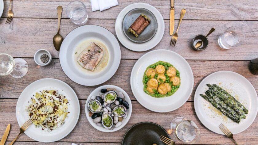 Salads, sea bass, oysters, cannoli, ravioli and asparagus at Alameda Supper Club.
