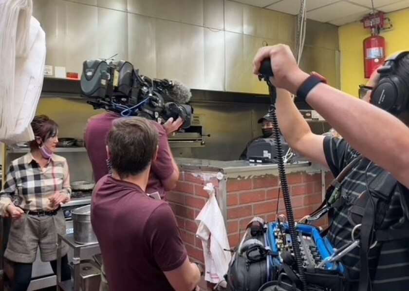 """Owner Liz Song at Incredible Cafe during filming of """"Restaurant: Impossible"""" on March 29."""