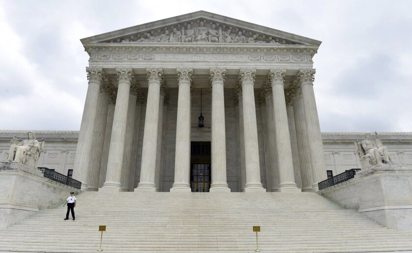 "The U.S. Supreme Court recently heard a case in which the federal government defined illegal possession of a gun as a ""violent felony."" Above, the Supreme Court building in Washington."