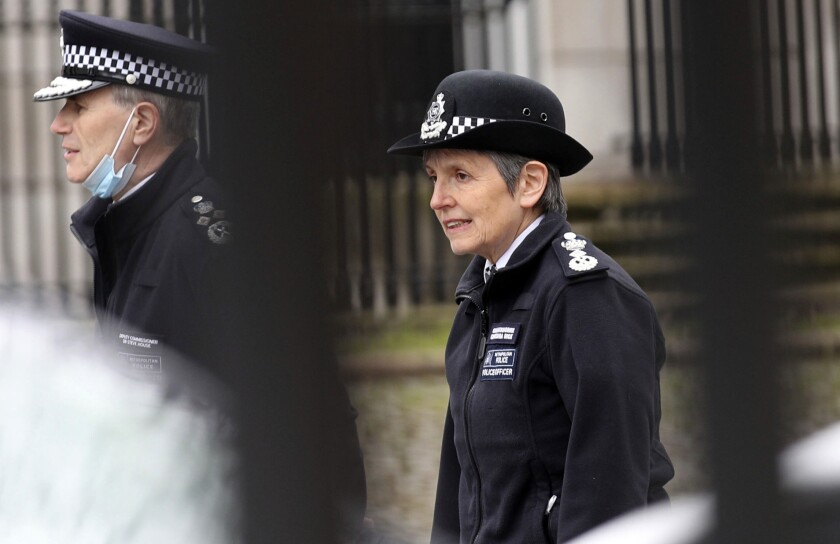 Metropolitan Police Commissioner Cressida Dick arrives at New Scotland Yard in London, Sunday March 14, 2021, the day after hundreds of people disregarded a judge's ruling and police requests by gathering at Clapham Common in honor of Sarah Everard. Everard disappeared while walking home from a friend's apartment and was found dead a week later. The slaying sent shockwaves across the U.K. because a Metropolitan Police officer is charged with her kidnapping and murder. (Yui Mok/PA via AP)