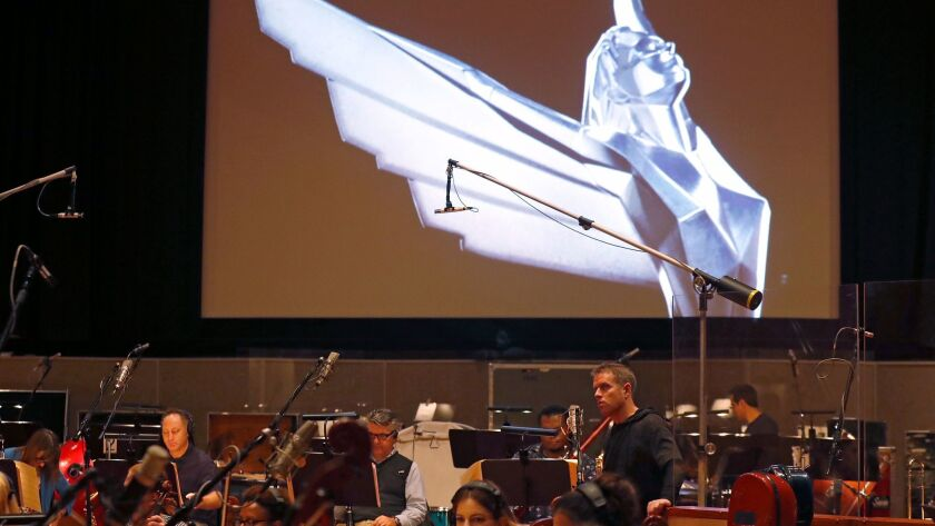 BURBANK, CALIF. - NOV. 18, 2017. Geoff Keighley listens to an orchestral recording session at Warn