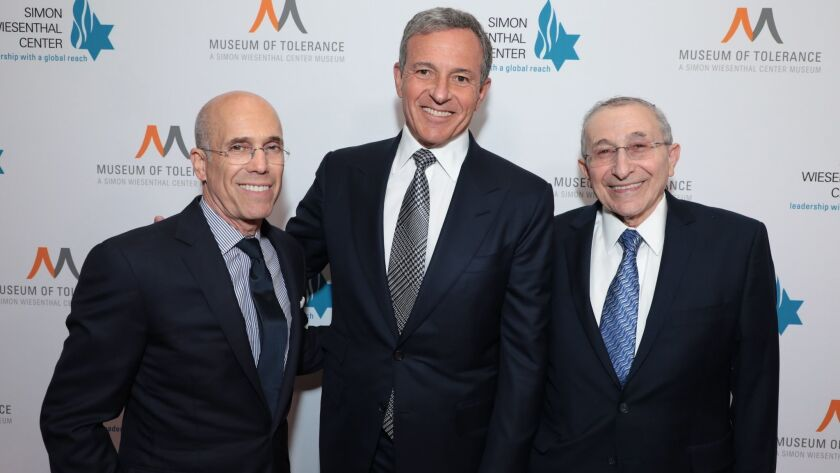 Jeffrey Katzenberg, left, Bob Iger and Rabbi Marvin Hier arrive as the Simon Wiesenthal Center honors Iger.