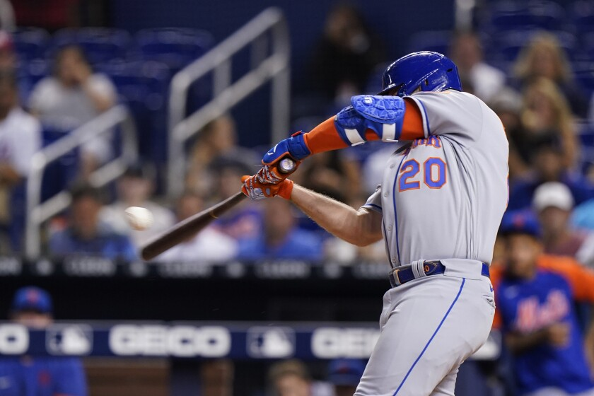 New York Mets' Pete Alonso hits a home run, scoring Francisco Lindor during the first inning of a baseball game against the Miami Marlins, Tuesday, Sept. 7, 2021, in Miami. (AP Photo/Wilfredo Lee)