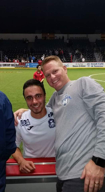 Arman Nadjafi with Rancho Bernardo boys soccer coach Kurt Trecker.