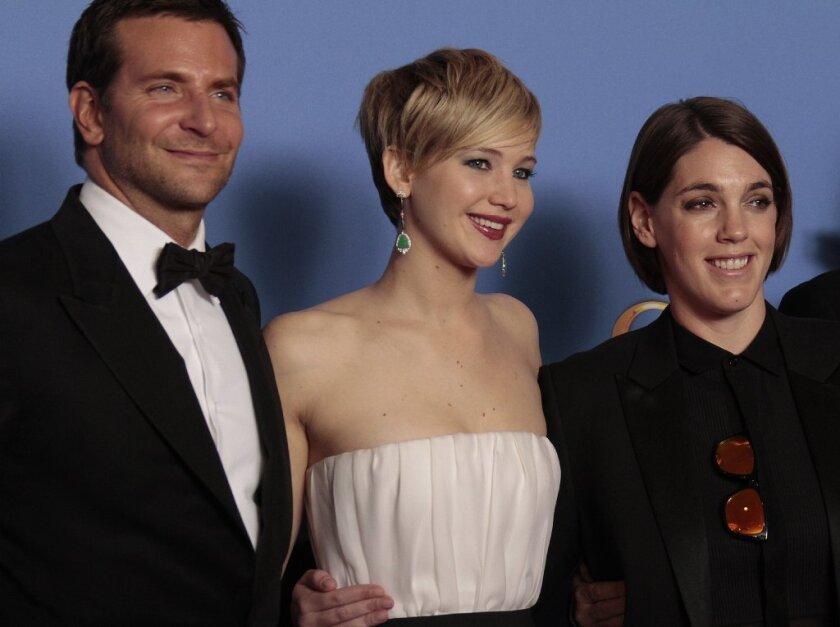Bradley Cooper, Jennifer Lawrence and Megan Ellison at the Golden Globe Awards show at the Beverly Hilton Hotel in 2014.