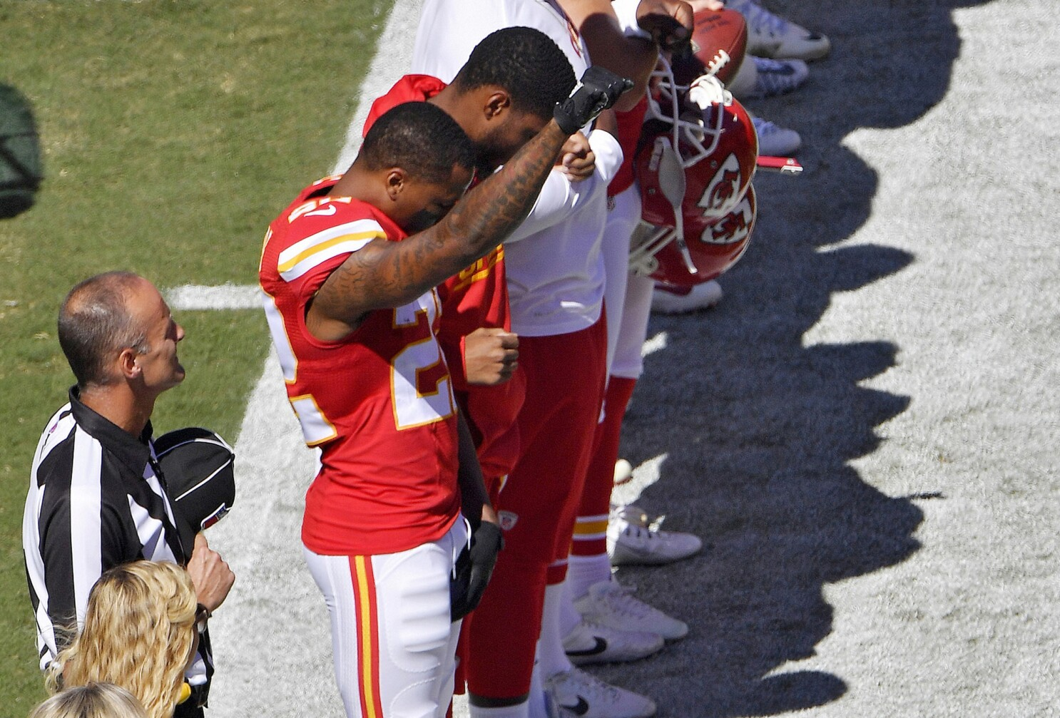 Around The Nfl Some Players Link Arms Or Raise A Fist In The Air During National Anthem Los Angeles Times