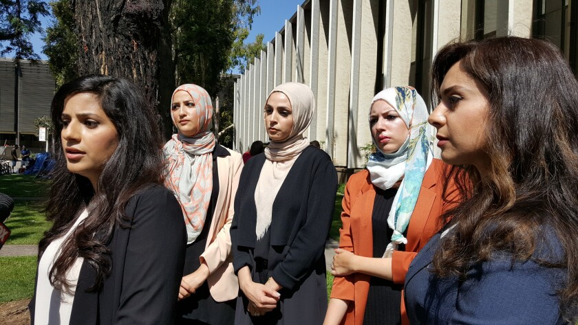 """Sara Farsakh, 29, left, with three other plaintiffs and one of their lawyers, who sued Urth Caffe in Laguna Beach for discrimination, alleging they were targeted in 2016 for being """"visibly Muslim."""""""